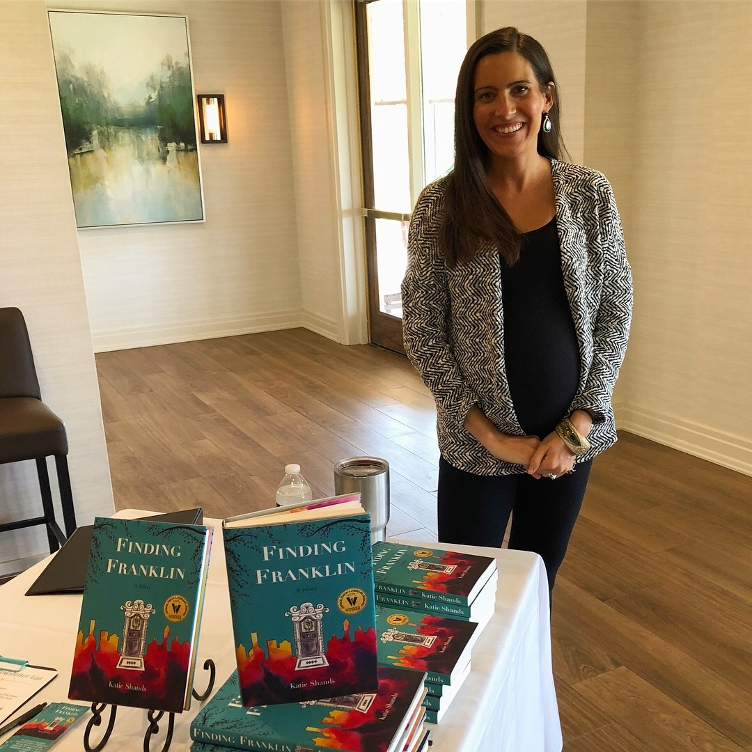 "Katie Shands poses with her book ""Finding Franklin"" at the October meeting of the Williamson County Newcomer's Club"